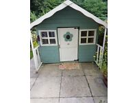 Wooden playhouse with lights and carpet, painted inside and out