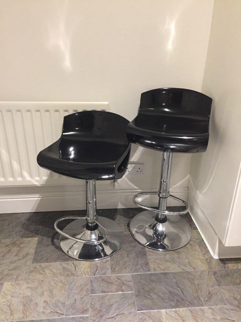 Two black bar stools