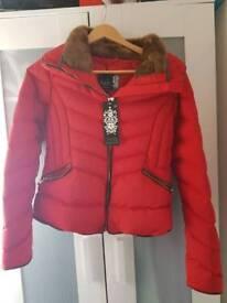 Red puffer coat.