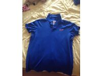 Blue Hollister polo shirt. In excellent condition as only worn a few times