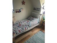 Single wooden sleigh bed