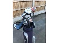 Golf bag and assortment of clubs.