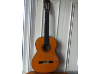 Superb Suzuki acoustic guitar with bag