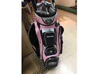 Ladies golf bag and a selection of clubs