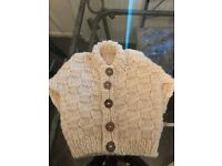 Hand knitted baby shawls, cardigans