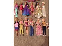 12 Barbie Dolls