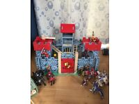 toy castle with knights and horses