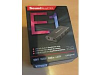 CREATIVE SOUND BLASTER E1 USB SOUNDCARD AND AMPLIFIER.