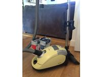 Melon yellow Miele vacuum cleaner