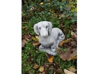 Sausage dog stone ornament garden