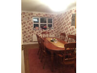 Solid hardwood dining table and 6 chairs with matching cushions