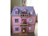 Wooden Dollhouseone with furniture and dolls. Good as new .