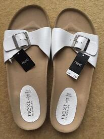Next new white flip flops- with tags