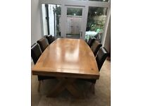 Ellipse shaped dining room table & six chairs