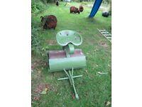 Tow along garden lawn roller