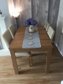 Extending oak table for sale