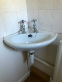 Small corner cloakroom basin with Heritage bathroom taps and waste. Collect Chichester