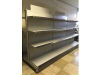 Set of three double sided shelving gondolas for use in warehousing, garage or retail units.