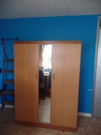 Large double wardrobe with full length mirror.