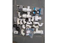 Assorted new and used plumbing fittingd