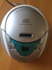 Portable CD player with radio