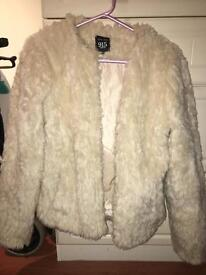 Beautiful beige faux fur jacket age 14-15 although tight fit