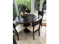 Dark wood dining table and matching chairs x 4
