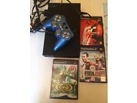 PlayStation 2 with some games