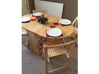 Oak Fold away Dining table and 4 chairs