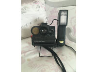 polaroid camera, sold with detachable flash