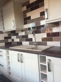 Shaker style kitchen for sale. In colour finish 'mussle' with brushed nickel handles.