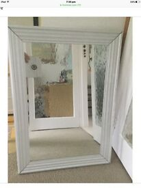 Bevelled edge mirror in silver coloured wooden frame