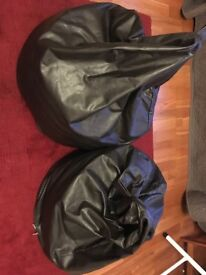 Pair of dark brown faux leather beanbags