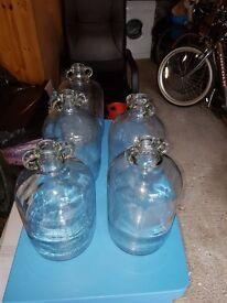 Glass vintage demijohns wine bottles.