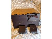 Two Monica Vinader ring boxes and bags