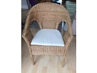 Crafted rattan chair with pillow