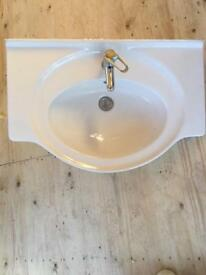 Large sink and tap