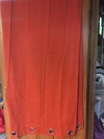 Pair of orange ring top cjrtains