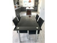 Lovely kitchen table and 4 chairs. Size is 150mm by 90mm. Original price was £379.99