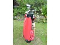 Set of golf clubs complete with bag