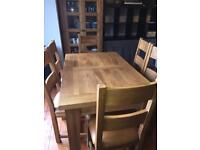 Solid oak extending dining table with six (6) chairs