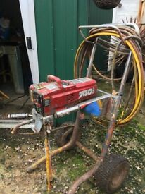 Titan 740i airless paint sprayer ,20meter hose and gun on wheels good condition.