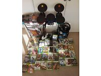 XBox 360 bundle. With 38 games, Rock Band set (Drums/Guitar/Mic) ,Racing wheel and 2 controllers.