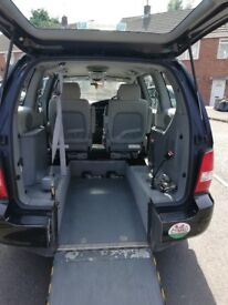 kia sedona 4 seat with whelchair access in black 67000 miles low milage