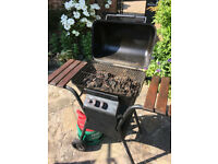 2 burner gas barbeque in matt black with patio gas bottle. In working order & good condition.