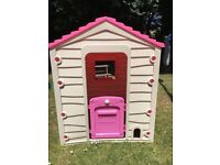 Pink Wendy house - used but lots of play still to be had!