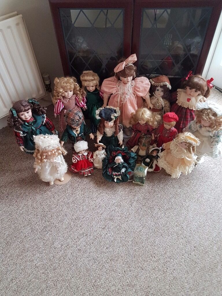 16 Assorted Porcelain Dolls. Small and large. Two sets of twins and a musical doll