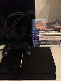PlayStation 4 for sale with accessories and games