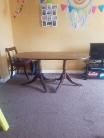 solid wood exstendable table with marks needs painting