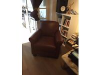 Brown faux leather armchair for quick sale, in good condition